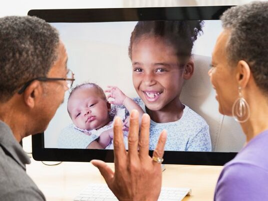 This image has an empty alt attribute; its file name is 1140-grandparents-videochatting.imgcache.rev_.web_.700.403-edited.jpg